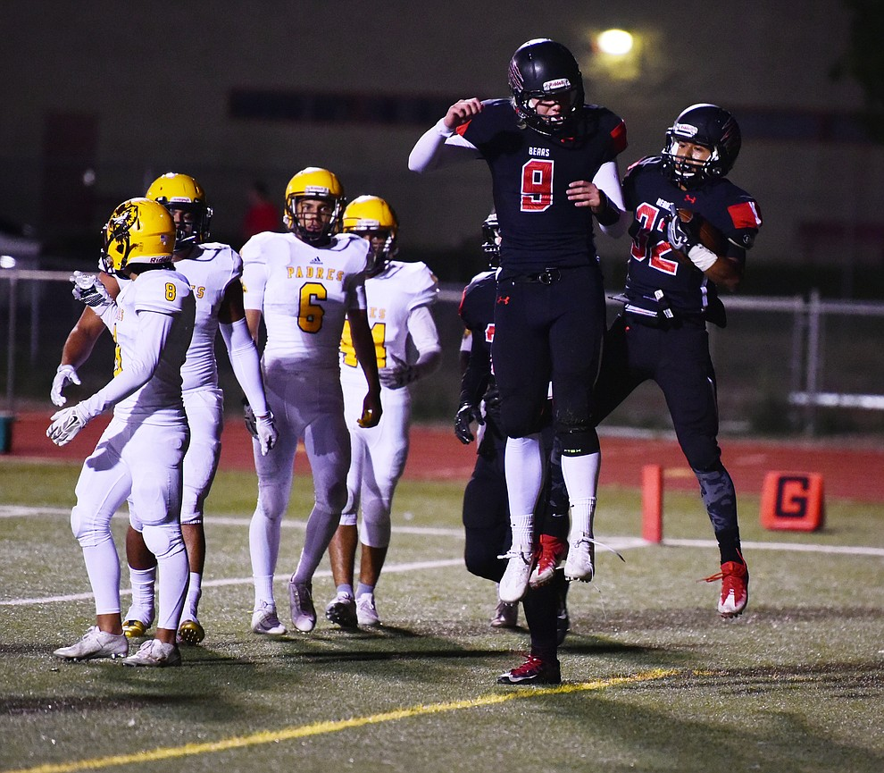 Bradshaw Mountain's Gunner Bundrick (9) and Abraham Hernandez (32) celebrate a touchdown as the Bears take on the Marco de Niza Padres Friday night in Prescott Valley. (Les Stukenberg/The Daily Courier)