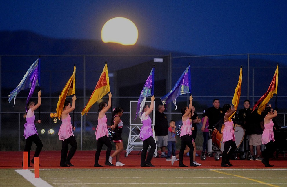 Bradshaw Mountain's flag line heads to the field before the Bears take on the Marco de Niza Padres Friday night in Prescott Valley. (Les Stukenberg/The Daily Courier)