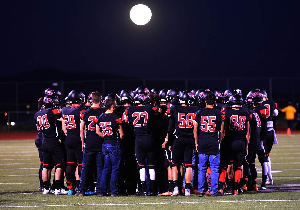 Bradshaw Mountain gathers under the full moon before the Bears take on the Marco de Niza Padres Friday night in Prescott Valley. (Les Stukenberg/The Daily Courier)