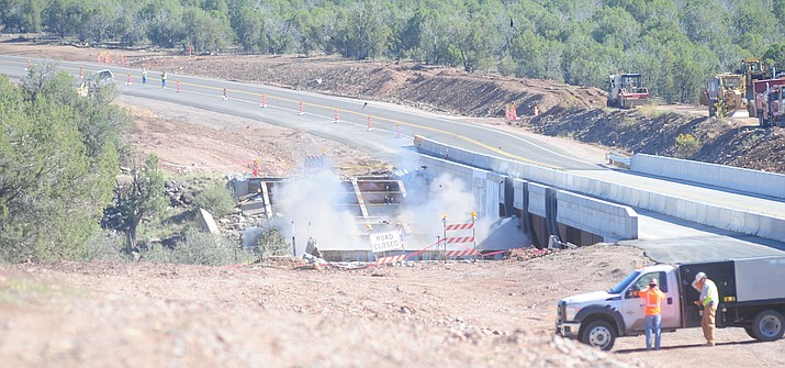 With a countdown from 10, the old Hell Canyon bridge on Highway 89 between Prescott and Ash Fork, Arizona went crashing into the canyon Friday, September 16, 2016. (Les Stukenberg/The Daily Courier)
