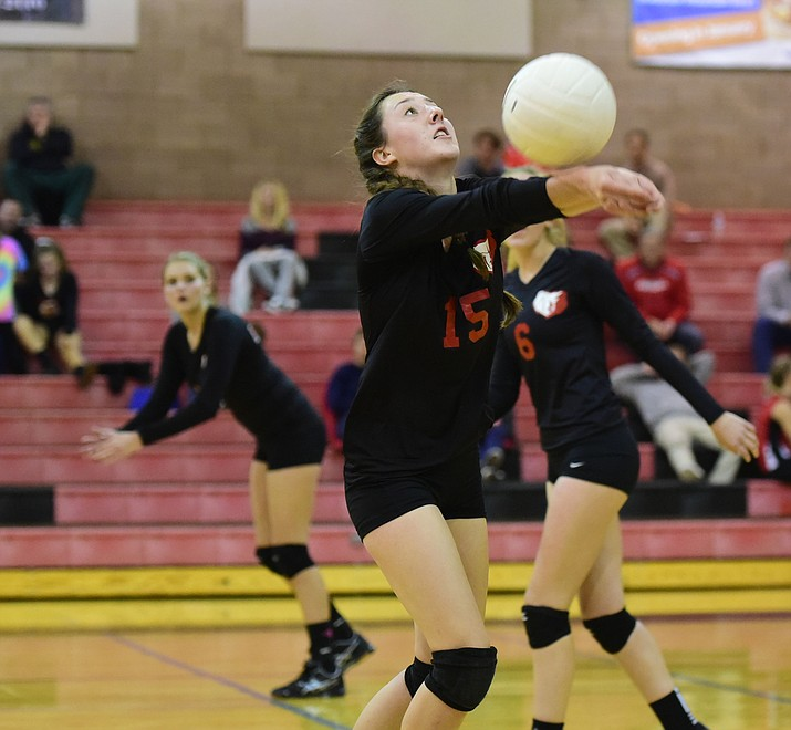 Bradshaw Mountain's Randee Clifford (15) sets the ball as the Lady Bears take on the Mingus Union Lady Marauders Tuesday night in Prescott Valley. (Les Stukenberg/The Daily Courier)