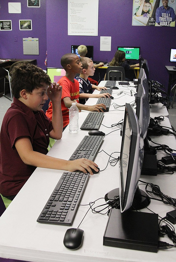 The new computer lab at the Boys and Girls Club of Kingman. Pictured from front to back using it are Julian, 10, Robert, 9, and Gage, 10, pictured Thursday.