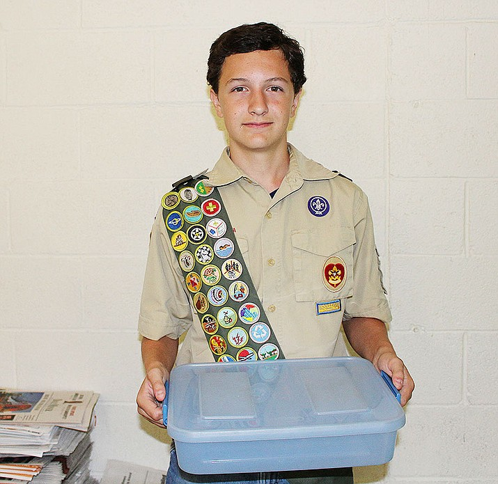 Nick Taflan, 13, hopes his helping library patrons with a Lego Club leads to him making Eagle Scout.