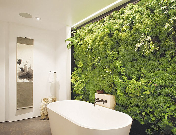 A 2013 photo shows a living garden bathroom wall at a private residence in San Francisco. The wall garden was designed by San Francisco-based integral design studio Siol Studios.