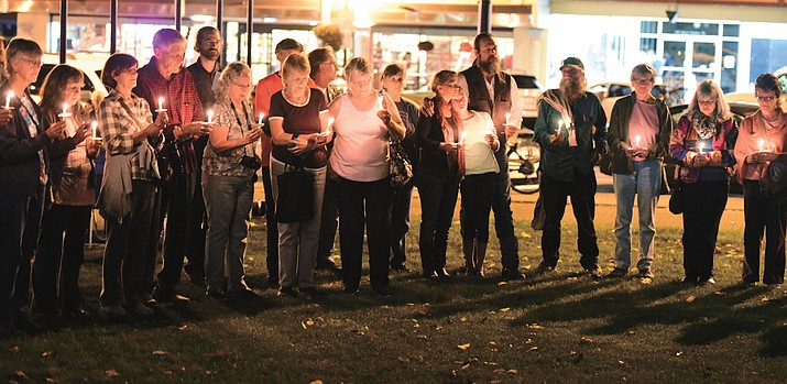 About 100 people gathered on the Yavapai County Courthouse Plaza for a candlelight vigil to celebrate the United Nations International Day of Peace Wednesday