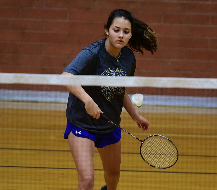 Mackenzie Schultz hits a return as the Prescott High School badminton team hosted Deer Valley Thursday afternoon. (Les Stukenberg/The Daily Courier)