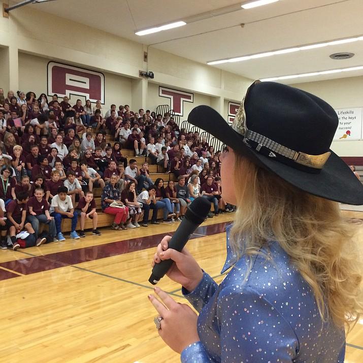 Baylee Hammond speaks to students at Kingman Middle School Wednesday.