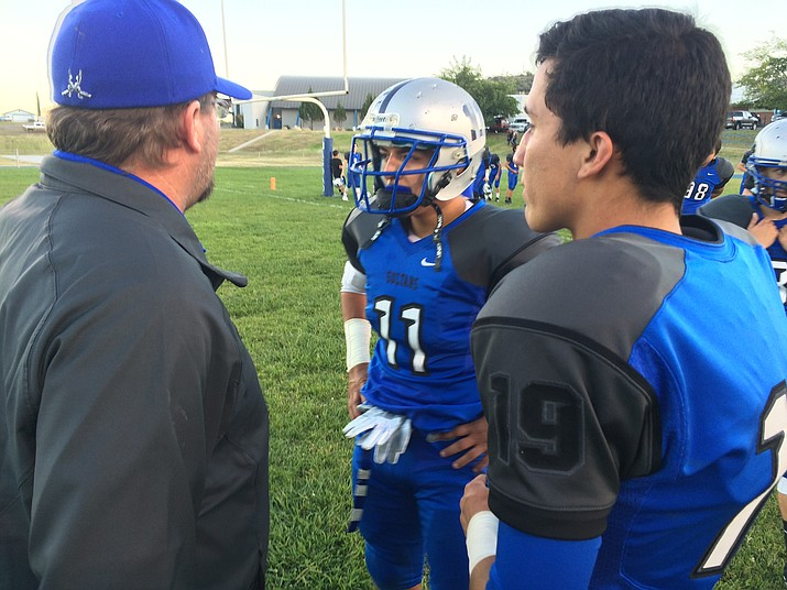 Bagdad's Ben Loveall (no. 19) with Michael Mendez and coach Dalton Mills.