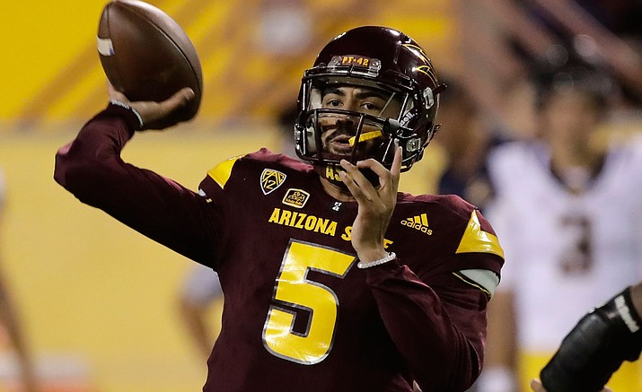 Arizona State quarterback Manny Wilkins (5) throws against California during the first half of an NCAA college football game, Saturday, Sept. 24, in Tempe.