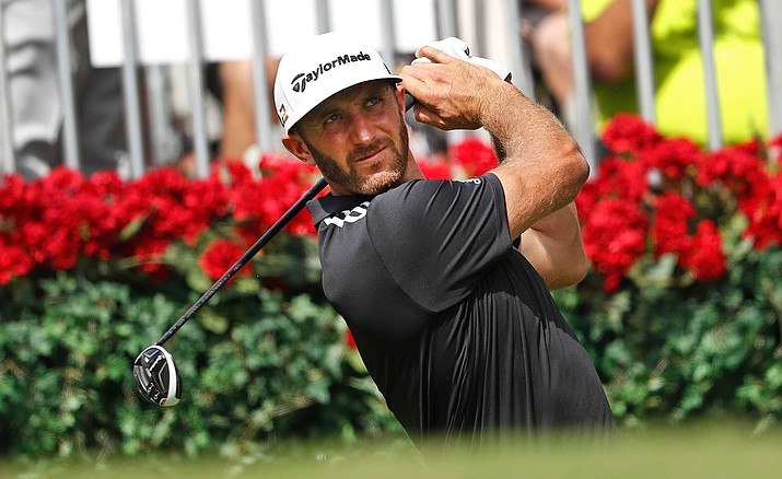Dustin Johnson hits from the tee on the first during the third round of play at the Tour Championship at East Lake Golf Club on Saturday in Atlanta.