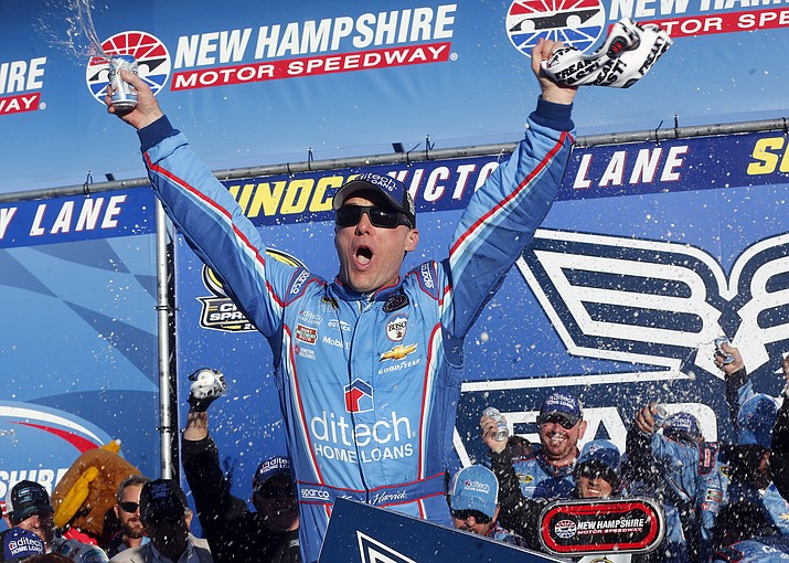 Kevin Harvick celebrates in Victory Lane after winning the NASCAR Sprint Cup Series auto race at New Hampshire Motor Speedway, Sunday, Sept. 25, in Loudon, N.H.