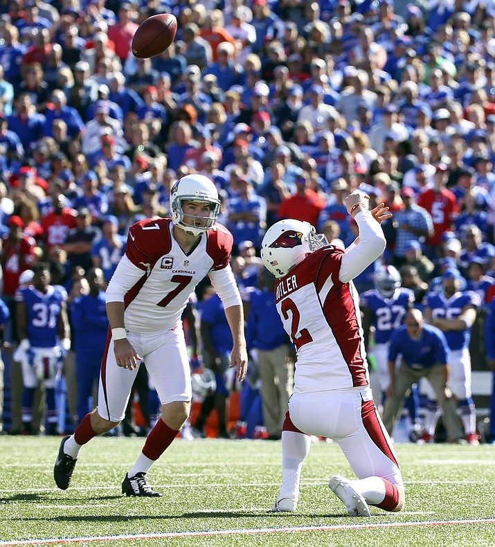 Arizona Cardinals holder Drew Butler can't handle a high snap in front of kicker Chandler Catanzaro (7) during the second half of their game against the Buffalo Bills on Sunday, Sept. 25, in Orchard Park, N.Y. Buffalo recovered and scored on the play.