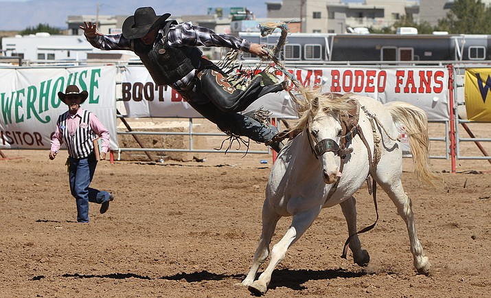 Wade Brown is thrown from his horse in the Ranch Bronc Riding event Sunday at the Andy Devine Days Rodeo.