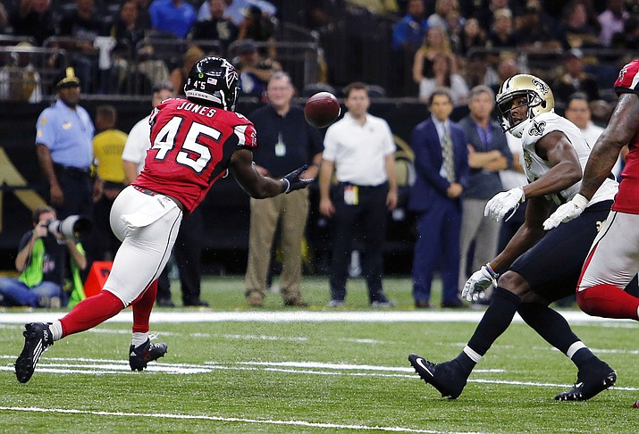 Atlanta Falcons outside linebacker Deion Jones (45) intercepts a pass from New Orleans Saints quarterback Drew Brees, not pictured, and returns it for a touchdown, in the second half of an NFL football game in New Orleans, Monday, Sept. 26.