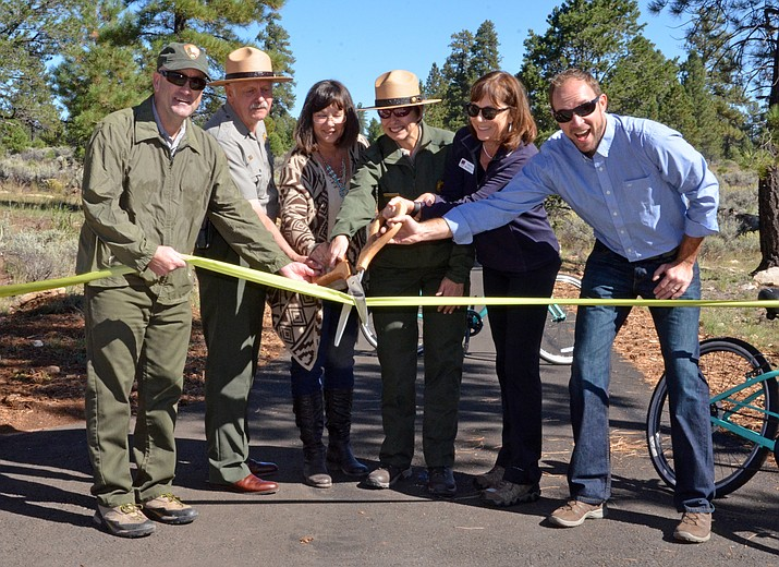 GCNP Deputy Superintendent Diane Chalfant cuts the ribbon on the newly-completed section of the Greenway Trail between Tusayan and the park.