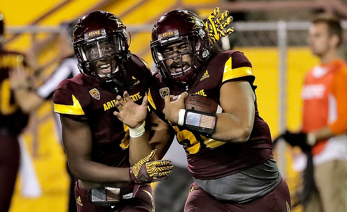 Arizona State linebacker Salamo Fiso, right, celebrates his interception with De'Chavon Hayes during the second half against California on Sept. 24 in Tempe. The Sun Devils won 51-41.