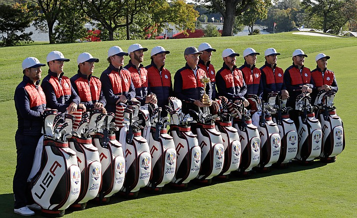 Members of the 2016 United States Ryder Cup team pose for a group photo before a practice round Tuesday at Hazeltine National Golf Club in Chaska, Minn.