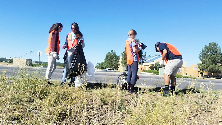 Local students help during the annual Clean and Beautiful event in Williams Sept. 17.