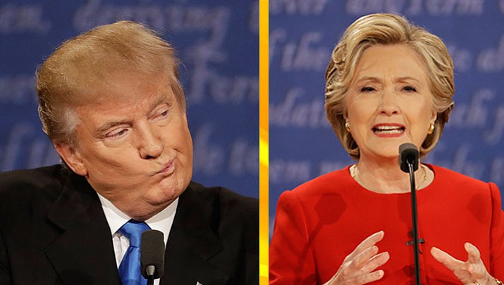 Republican presidential nominee Donald Trump, left, listens to Democratic presidential nominee Hillary Clinton during the first presidential debate at Hofstra University in Hempstead, N.Y., Monday, Sept. 26. The second presidential debate will be Oct. 9.