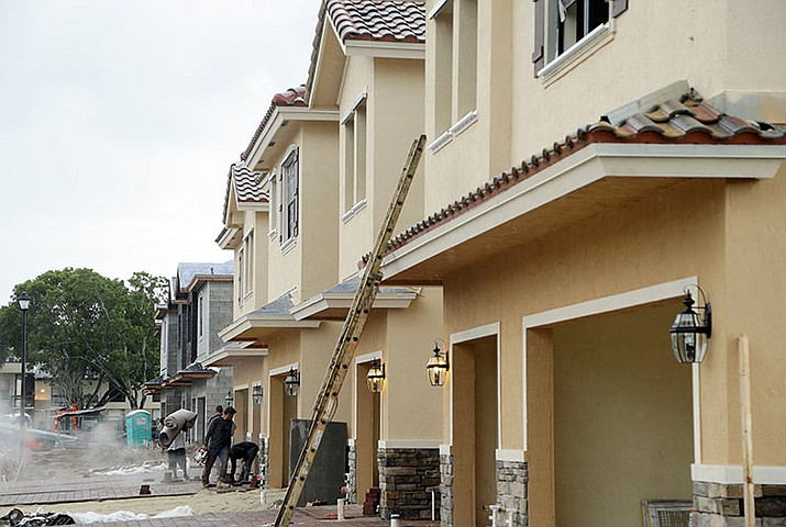 Lennar Corporation townhomes are under construction at Chelsea Place in Tamarac, Fla. Sales of new homes plummeted everywhere except the West, according to the latest report from the Commerce Department.
