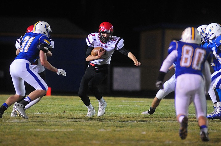 Lee Williams' Andrew Herrera looks for room to run last week at Prescott. Herrera and the Volunteers host Coconino in Lee Williams' Homecoming Game at 7 p.m. today.