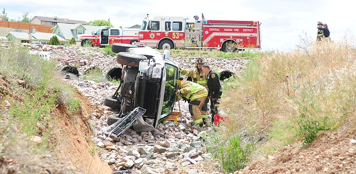 Central Yavapai firefighters and Prescott Valley Police check on the single vehicle rollover into a ditch near the intersection of Lakeshore and Tonopah Drives Monday afternoon. Emergency personnel transported the driver to Yavapai Regional Medical Center with non-life threatening injuries.