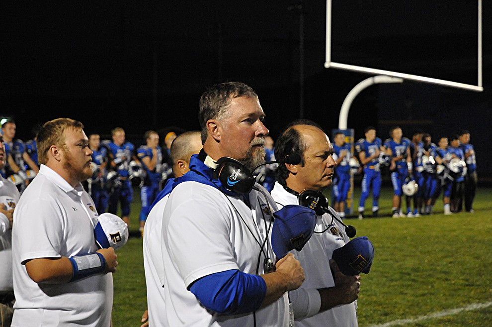 Prescott football head coach Michael Gilpin, center, stands with his coaching staff during the national anthem at homecoming Friday, Sept. 30. Prescott (4-2, 2-0 4A Grand Canyon) earned a 43-14 win over Mohave. (Brian M. Bergner Jr./The Daily Courier)
