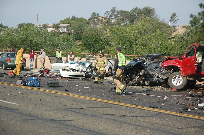 Police and firefighters begin the process of investigating a fatal crash on Willow Creek road Tuesday morning.