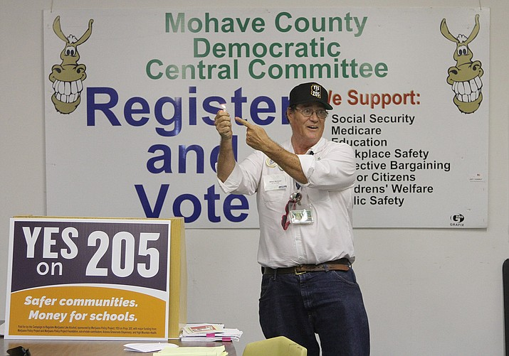 Above, Mikel Weisser speaks about marijuana at a Prop 205 Public Forum at the Mohave County Democratic Central Committee meeting on Thursday evening.