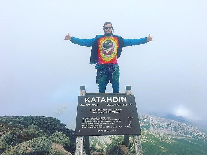 Jon Casson celebrates hiking the Appalachian Trail at the iconic finish line at mile 2,189.1.