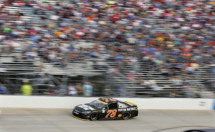 Martin Truex Jr. (78) drives during a NASCAR Sprint Cup Series auto race, Sunday, Oct. 2, at Dover International Speedway in Dover, Del. Truex  won the race.