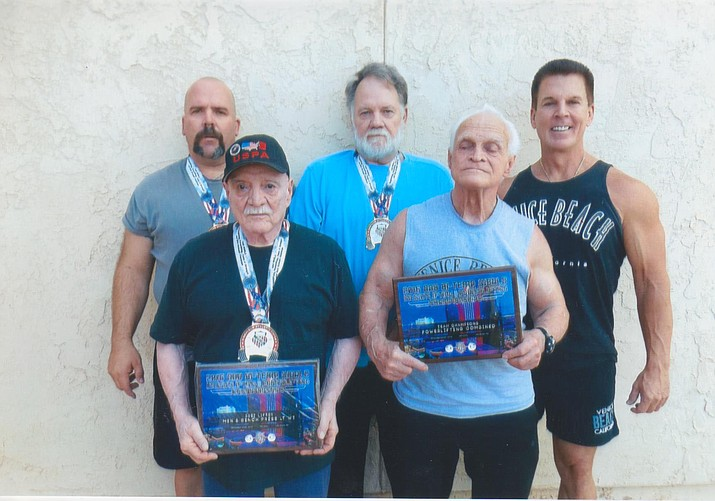 Kingman Ancient Iron won seven events while setting four world records Sept. 23-25 in Las Vegas. From left to right in front are John Lopez and Jerry Homer Sr. In back are Joe Harris, Charley Jones and Jerry Homer Jr.