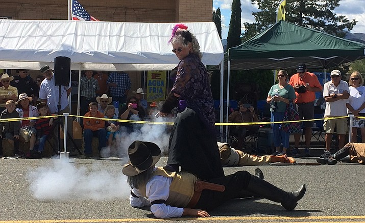 One of the Shady Ladies shoots a Prescott Regulator during a shootout at the 109th Annual Agua Fria Festival.