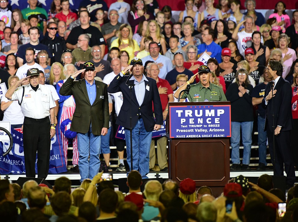 Local veterans salute for the Pledge of Allegiance at the Donald Trump for President Rally in the Prescott Valley Event Center Tuesday, October 4, 2016. (Les Stukenberg/The Daily Courier)