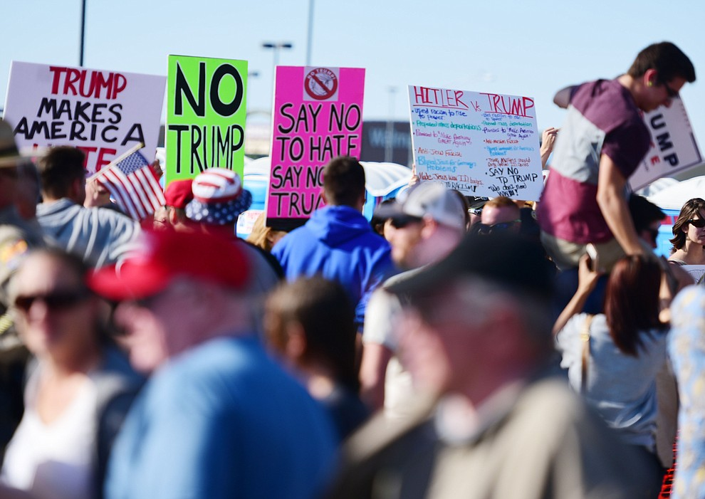 Supporters and protesters interact at the Donald Trump for President Rally in the Prescott Valley Event Center Tuesday, October 4, 2016. (Les Stukenberg/The Daily Courier)