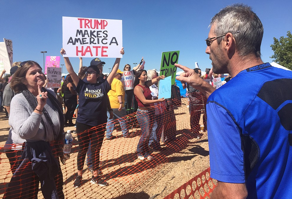 Protesters and supporters get into some finger wagging at the Donald Trump for President Rally in the Prescott Valley Event Center Tuesday, October 4, 2016.
