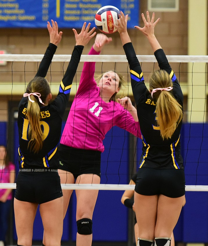 ERAU's Jalin Yoder (10) and Leah DeLaurell (3) go for the block on Yavapai's Baylie Stephens (11) as the Lady Eagles hosted the Yavapai College Lady Roughriders in the annual Battle Against Breast Cancer volleyball game Wednesday night. (Les Stukenberg/The Daily Courier Photo)