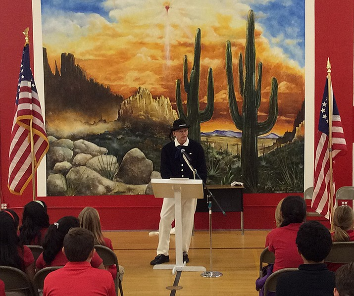 At the Sacred Heart Catholic School in Prescott, The Arizona Society of the Sons of the American Revolution Prescott Chapter Vice-President Wayne Hood talks with some 150 students about issues related to the founding of this nation.
