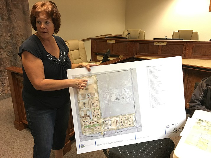 Danielle Feller shows plans for the Chino Valley Equestrian Association's new facility at Old Home Manor. The equestrian park should be able to stage events as early as the spring.