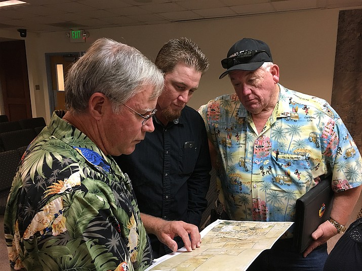 (From left) Chino Valley Mayor Chris Marley, John Brinkley and David Brinkley look over plans for Old Home Manor. The Brinkleys want to build a motorsports facility there.