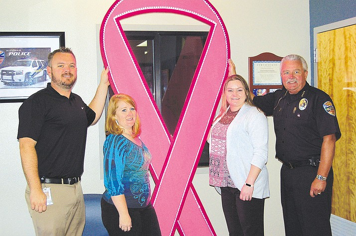"The Kingman Police Department was awarded Kingman Regional Medical Center's Pink Ribbon of Lights for best decorated establishment during ""Go Pink Week"" in 2015.  Pictured, from the left, is Scott Kern, KRMC director of development, Tiffany Reed, Jennifer Sochocki, and Chief Robert DeVries of the Kingman Police Department. Businesses and organizations throughout Kingman are encouraged to compete for this year's award by decorating their establishment as pink as possible to show support for people in the community who are touched by cancer."