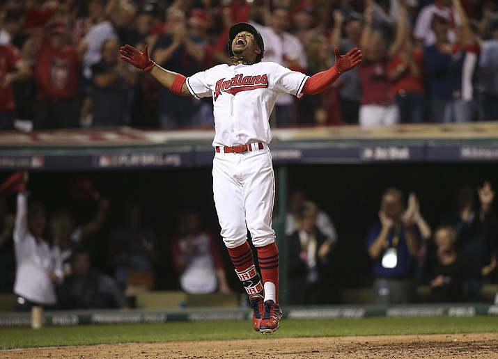 Cleveland Indians' Francisco Lindor celebrates his solo home run against the Boston Red Sox in the third inning during Game 1 of baseball's American League Division Series, Thursday, Oct. 6, in Cleveland.