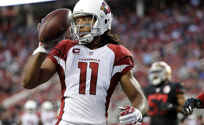 Arizona Cardinals wide receiver Larry Fitzgerald (11) scores on a touchdown reception during the first half Thursday against the San Francisco 49ers in Santa Clara, Calif.