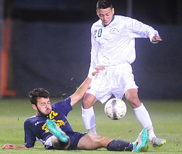 Yavapai College men's soccer player Santos Villasenor (20) takes the ball away from Christian Hurtado (22) as the Roughriders host Phoenix College Thursday, Oct. 6, in Prescott. (Les Stukenberg/The Daily Courier Photo)