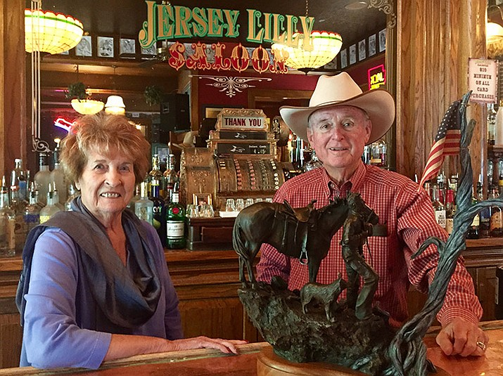"Joan and Tommy Meredith display the western sculpture that will be the raffle prize in this year's Friends of Jersey Lilly Courthouse Lighting Fundraiser. The piece, titled ""Tribute at Dawn,"" was sculpted and donated by local artist Bradford Williams."