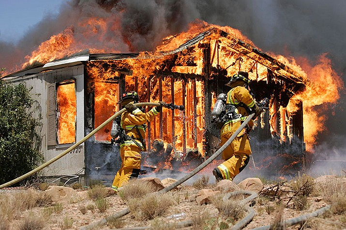 Central Yavapai firefighters have their hands full with this fully involved structure fire in Dewey in 2007.