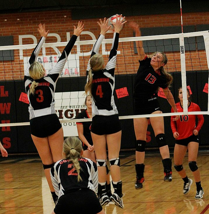 Lee Williams' Kayla Liest (13) hits a kill attempt against Coconino during the Lady Vols' loss Thursday at LWHS.