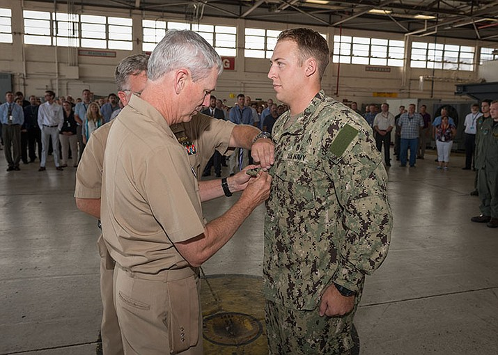 Commander, Naval Sea Systems Command Vice Adm. Thomas Moore, USN, meritoriously promotes Petty Officer 2nd Class Jesse Reeves, a graduate of Mingus Union High School in Cottonwood, Arizona, to second class petty officer Sept. 28, 2016. Reeves is a Navy diver assigned to Naval Surface Warfare Center Panama City Division.