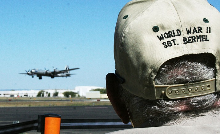 Anthony Bermel, a World War II veteran, now 98, watches the Commemorative Air Force's B-29 Superfortress take off from Prescott Airport on Sunday, Oct. 9.