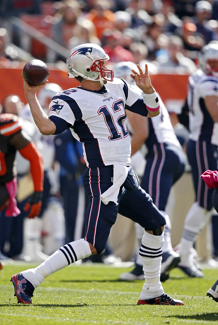 New England Patriots quarterback Tom Brady passes against the Cleveland Browns in the first half of their football game Sunday, Oct. 9, in Cleveland.